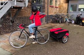 Spedal cyclist with delivery cart